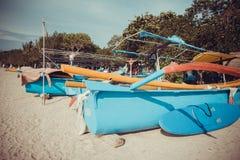 Barcos na praia de Kuta Imagem de Stock Royalty Free