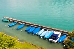 Barcos no cais no lago Thun, Suíça Imagens de Stock Royalty Free