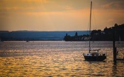 Barcos no por do sol no constance do lago Imagens de Stock
