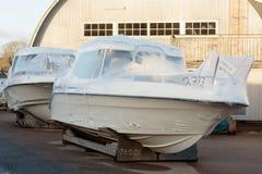 Barcos novos na embalagem plástica Fotos de Stock Royalty Free