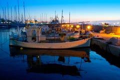 Barcos pesqueros tradicionales de la puesta del sol en Formentera Foto de archivo