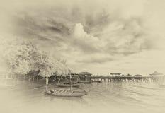 Barcos que atracan en la playa imagenes de archivo