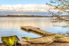 Barcos a remos pelo lago Imagens de Stock