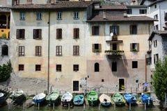 Barcos y casas en Gandria Foto de archivo libre de regalías
