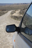 Bardenas Reales Park with Car Wing Mirror; Navarre Royalty Free Stock Images