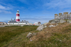 Bardsey Island Lighthouse and old fort. Bardsey Island Lighthouse a small Isla off the end of the lLyn Peninsula North Wales UK royalty free stock photos