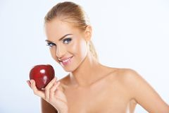 Bare Attractive Woman Holding Dark Red Apple Royalty Free Stock Images