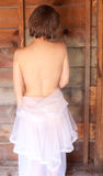 Bare Back and Wooden Wall Royalty Free Stock Photography