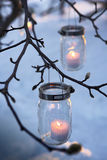 Bare branches with sparkling votives Stock Photo