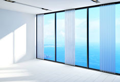 Bare bright white room overlooking the ocean Royalty Free Stock Image