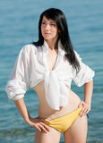 Bare brunette at the sea Royalty Free Stock Photos