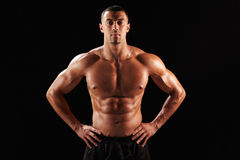 Bare chested male body builder with hands on hips Royalty Free Stock Images