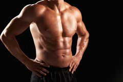 Bare chested male body builder with hands on hips, crop Royalty Free Stock Photography