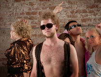 Bare chested man at disco party Stock Image
