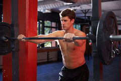 Bare Chested Man In Gym Preparing To Lift Weights Royalty Free Stock Photos
