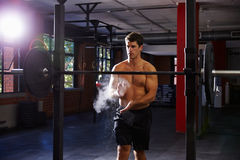 Bare Chested Man In Gym Preparing To Lift Weights Royalty Free Stock Image