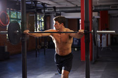 Bare Chested Man In Gym Preparing To Lift Weights Stock Photo