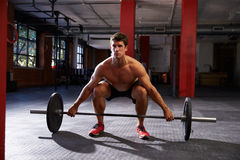 Bare Chested Man In Gym Preparing To Lift Weights Stock Photos