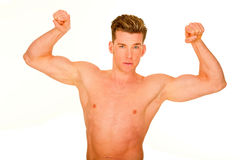 Bare-chested man showing muscles Royalty Free Stock Image