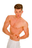 Bare-chested man showing muscles Royalty Free Stock Images