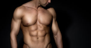 Bare chested muscle man Stock Images