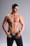 Bare Chested Young Man. Muscular young man standing bare chested in black jeans Royalty Free Stock Photos