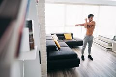 Adult Man Fitness Training At Home Stretching Muscles Before Workout royalty free stock photo