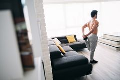 Adult Man Fitness Training At Home Stretching Muscles Before Workout stock photos