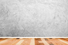 Bare concrete room wall with wooden floor texture. Royalty Free Stock Photos