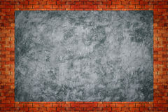 Bare concreter with old brick wall texture. Royalty Free Stock Photo