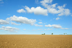 Bare Farmland. Landscape View of a Ploughed Field in Rural Wiltshire in England Royalty Free Stock Photo