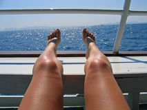 Bare feet. Of the women and sea stock photo