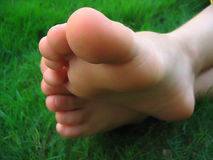 Bare feet. On the grass stock photos