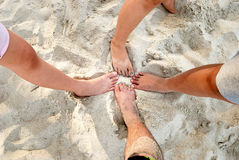 Bare Feet. Two pair of bare feet covered by beach sands stock photography