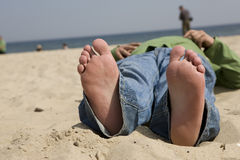 Bare feet on the beach Royalty Free Stock Photo