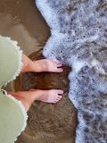 Bare feet on the beach stock photos
