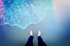 Bare feet on the beach. Stock Photo