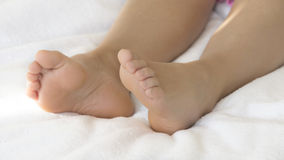 Bare feet in bed Stock Photos