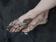 Bare feet black sand. On beach Royalty Free Stock Photography