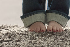 Bare feet on carpet Stock Photography