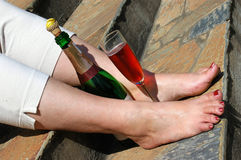 Bare feet with champagne Royalty Free Stock Photo