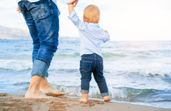 Bare feet of child and adult on the sea. vacation concept. Happy family concept Royalty Free Stock Photography