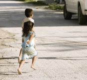 Bare feet children. On street of Yucatan village running for tourists bus, Mexico Stock Photos