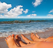 Bare feet of children on the beach Royalty Free Stock Photos