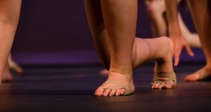 Bare feet of  a classic dance performer. Bare feet of classic dancer with more dancers in the background Stock Photography