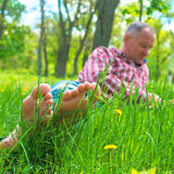 Bare feet closeup among green grass Royalty Free Stock Photography