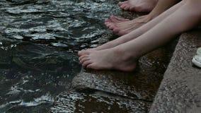 Bare feet closeup water stock footage