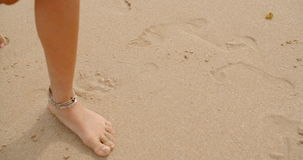 Bare Feet Coated in Sand Walking on Beach