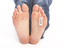 Bare feet of a dead man in the morgue Royalty Free Stock Photos