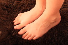 Bare feet on fur Stock Photo
